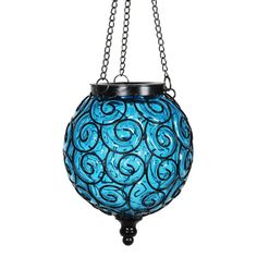 15 Solar powered fairy firefly LEDs automatically illuminate at dusk. Provides a beautiful and decorative accent light. Ready to hang. Made of hand blown color infused glass and metal. UV treated to resist fading. Exhart 6.88-in x 20.5-in Blue Metal Solar Outdoor Decorative Lantern   13171-RS Outside Hanging Lights, Decorative Solar Lights, Outdoor Solar Lanterns, Glass Garden Art, Garden Lamps, Lanterns Decor, Dusk, Metal, Scroll Design