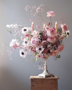 Candelabra bouquet with anemones and roses.