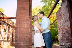 romantic kiss, holding tight, sweet love, red brick, modern photography, portraiture, engagement photos, great ideas :: Katie + Michael's Engagement Shoot at Whittier Mill Park in Atlanta GA :: with Jen