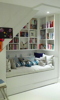 Cosy use of that space underneath the stairs.