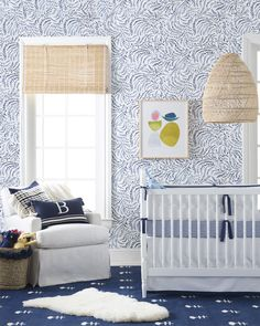 This is nursery inspiration. This blue nursery with a white spindle crib is completed with a patterned wallpaper, patterned rug, rattan light pendant, and throw pillow styling. White Nursery, Nursery Room, Nursery Decor, Bedroom Decor, Bedroom Ideas, Project Nursery, Bedroom Wall, Nursery Ideas, Baby Room