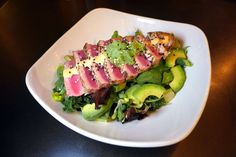 Bite into a seared rare 4 ounce ahi tuna salad with spicy organic ...