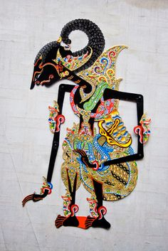 "Wayang is an ancient Javanese word meaning ""shadow"" or ""ghost."" It is also the name for the traditional sacred dramas of Java and Bali. There are seven main forms of wayang, but wayang kulit, or shadow-puppet theater, Living Puppets, Wallpaper Hp, Wallpaper Keren, Cultures Du Monde, Shadow Theatre, Indonesian Art, Batik Art, Dutch East Indies, Spiritus"