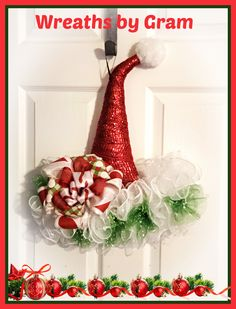 Christmas wreath; christmas decor ideas; christmas hat wreath; christmas gifts; holiday wreaths; handmade gifts; santa hat wreath; red and white aesthetic; red and white christmas decor; santa hat door hanger; secret santa gifts; holiday decor; holiday door hangers; winter birthday ideas; wreaths for front door; homemade gifts; grandma gifts; birthday gifts for mom; birthday gifts for best friend; home decor ideas; thinking of you #christmasgifts #handmadegifts #wreaths #giftideas