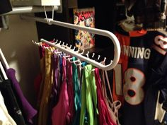 Organize tank tops with this tie rack pull-out! Available at Lowes on clearance now for $5!