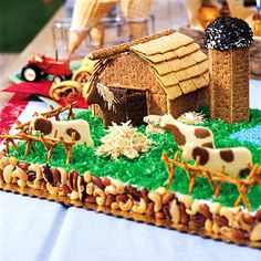 This farmyard cake is a real show-stopper. The mixed nut border adds crunch to the fluffy sheet cake. Blue granulated sugar is a cool pool amid lush green coconut grass. Pretzel sticks create a crisscross fence and shredded wheat biscuits look just like haystacks.  Top off your creation with a Graham Cracker Barn and Silo recipe.   {Recipe and instructions at BHG}