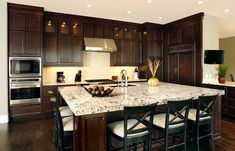 Kitchen with island seating.  Love the seating on both sides.