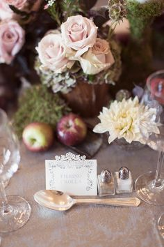 This wedding reception place card is so cute. Love the laser cut pattern; photo: Craig And Eva Sanders Photography