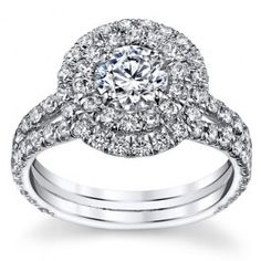 $2,699.99 USD, The center stone can be customized between 0.50-1.00ct round brilliant cut diamond. It has a gorgeous halo setting with round cut diamonds as the side stones in a total of 1.50 carat weight. The side stones are set just below half way down the band in a prong setting and an etching design under the center stone. Can be complemented in 14k Gold, 18k Gold or Platinum 950 setting.