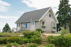 Goose Rocks Beach Cottage, a 960 sq. ft. cottage in Kennebunkport, Maine. With a blue door... All that's missing is a weathervane of a woman lounging on a crescent moon.
