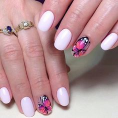White with butterflies on nails
