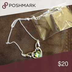 Peridot necklace Peridot birthstone necklace. It's a heart with wings. Brand new Jewelry Necklaces