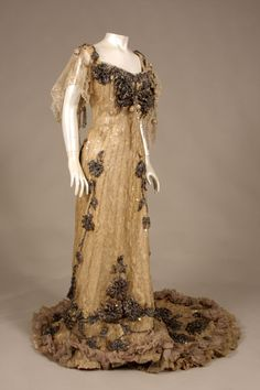 """Evening gown by Charles Poynter for the House of Redfern, Paris, circa 1904:  silk taffeta, silk satin, silk plissé chiffon, machine-made Brussels lace, iridescent sequins, and beads  Label: """"Brevet. Redfern / Paris / By Special Appointment to H.I.M. — Empress of Russia / By Special Appointment to H.R.H. — Princess of Wales""""  Museum of the City of New York."""