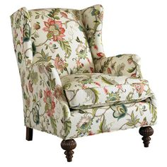 Wingback arm chair with a wood frame and floral-print upholstery. Made in the USA.    Product: ChairConstruction Mat...