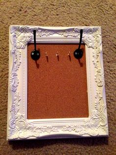 DIY Cork board jewelry holder. Made with cork board, frame, and hooks all from hobby lobby. It turns out they also sell finished products just like this that cost less than the supplies did to make it, but I think mine turned out much prettier than anything they had in store.