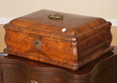 "18th century sewing box, European, solid figured walnut, parquetry geometric pattern and scrolls around brass handle on dome top, ogee shaped sides, secret drawer behind removable side, hinge compartment under top of lid, fitted interior, 18"" wide 13"" deep 8"" tall"