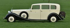 1935 Rolls Royce Phantom II Limousine arrived like a ghost out from the thick sliver fog. Hannah AKA Magnolia Doll