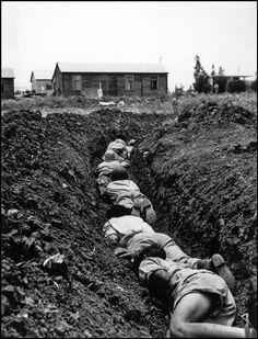 Photo © Robert Capa//ICP [Members of a Kibbutz hiding in a trench during an Arab air-raid, Israel], May-June, 1948