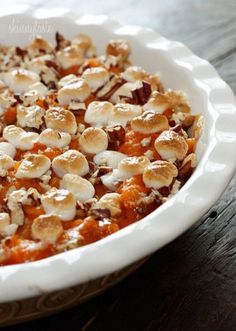 Marys Sweet Potato Casserole: Three large sweet potatoes cooked and skinned beat with evaporated milk ,butter ,1/4 cup brown sugar, cinnamon. Put in casserole dish top with marshmallows butter and brown sugar mixture& walnuts