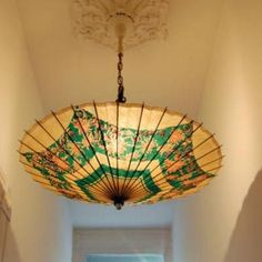 Beautiful umbrella turned ambient light.   Note the ceiling medallion adding sophistication and elegance.