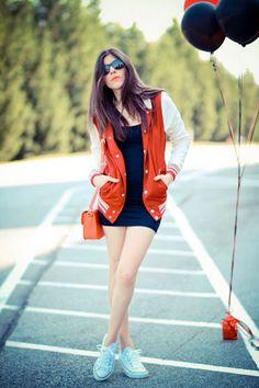 Red Varsity jacket and naive dress. Looks like excellent.