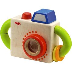 Spark the imagination with this fun first camera from Haba. Peer through the prism to see a world of fun and press down on the red button to capture the moment! Age: 1+ years