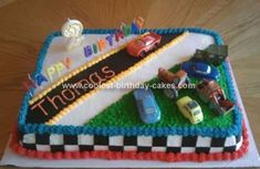 @Rachel Resciniti This cake isn't all that complicated and gives him some cars to play with after the cake is gone. You and Toby used to love cakes with things on it that you could keep.