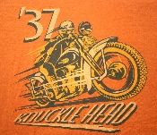 Harley-Davidson Knucklehead T-Shirt in a size medium. The shirt is made from 100% pre-shrunk cotton and is in mint condition. It's burnt orange in color and features graphics on the front and back. The shirt is emblazened with a 1937 Knucklehead from Wheels Through Time in Maggie Valley, North Carolina. Harley Davidson Knucklehead, Harley Davidson T Shirts, Maggie Valley North Carolina, Burnt Orange, Wheels, Mint, Graphics, Medium, Cotton