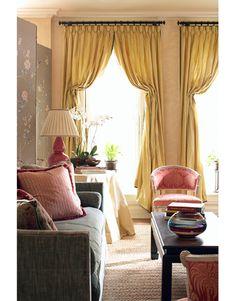 mustard velvet drapes and grey velvet sofa