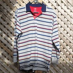 GAP Boy's Striped long sleeve shirt Boys XXL (14-16). Runs larger like a men's small. Grey, red, blue, orange & white stripes. Navy collar. Very soft, medium thickness, clean and in like new condition. Always gently washed and line dried. GAP Tops