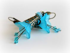 Hey, I found this really awesome Etsy listing at http://www.etsy.com/listing/96285726/morning-glory-sky-blue-vintage-earrings