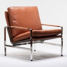 A true masterpiece stands the test of time! The Kurt lounge chair in cognac leather features the iconic stainless steel design topped with loose analin leather cushions in a handsome brown congnac. The perfect addition for your home or office, this easy chair allows to work and lounge in effortless style!