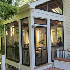 A screened porch. Love the vaulted roof and black trim around the screen frames & door. Beautiful!