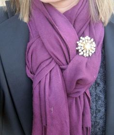 How to tie this knot: http://basiccravings.wordpress.com/2011/01/26/knotting-your-pashmina/