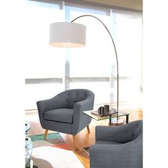Sweeping Arc. The Salon floor lamp's sweeping metal arc gracefully culminates in a circular, white fabric lampshade. The round plate base anchors the lamp and has rubber coasters to protect floors. A web-exclusive product. Item is not displayed in store, but may be ordered there.