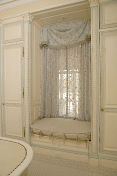 window seat ideas: don't like the pattern but the style of curtain would be perfect for my window seat