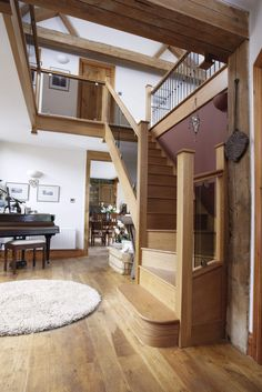 This glass and iron staircase combines timber, glass, and iron for a unique but stunning look. Special features include bronzed glass and black spindles.