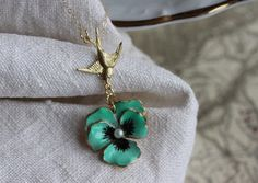 Green Pansy Necklace, Green Flower Necklace, Flower Necklace, Pansy Jewelry  This darling sweet pendant necklace features a rare vintage enamel Green