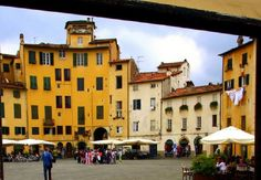 The lively yellow buildings of Lucca