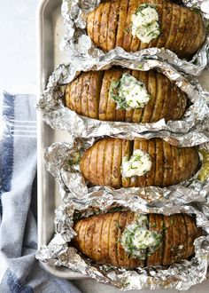 """These hasselback potatoes with chive butter are baked right on the grill! Couldn't pass up sharing these fabulous grilled hasselback potatoes with you, because grilling season isn't over yet! And why turn on the oven if you don't have to, right? These """"ba Grilled Baked Potatoes, Bbq Potatoes, Hasselback Potatoes, Grilled Vegetables, Baked Potato On Grill, Vegetables On The Grill, Potatoes On The Grill, Cabbage On The Grill, Butter Potatoes"""
