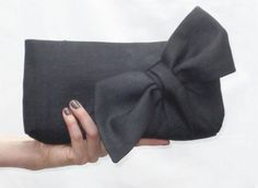 SEE MY FULL RANGE OF SEWING PATTERNS www.etsy.com/shop/ConstructivPatterns Now available to instantly download! This PDF file sewing pattern is for a structured, zipped clutch with a beautiful sumptuous bow on the front. The bow is not stuck on, instead its integrated into the body of the front panel. The fabric is pieced together and gathers up to form the bow, like a perfectly wrapped gift! You can choose to make the standard length of bow as the black clutch pictured, or follow...
