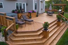 deck with planters & wide steps cascading down... Now this I would ...