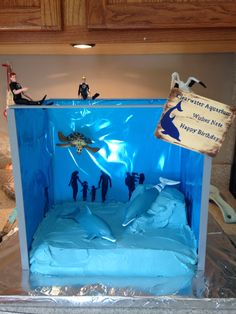 I made this Dolphin Tale, aquarium cake with Winter and Hope toys purchased from the Clearwater Aquarium. :)