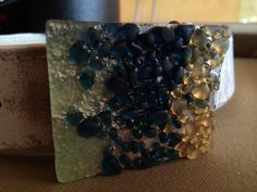 Caviar Collection:  3-dimensional, handmade, fused glass belt buckle by Miss Olivia's Line.  Additional items posted at https://www.facebook.com/MissOliviasLine