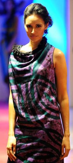 A Sri Lankan model displays a creation by designer Cotton Collection during a fashion event in Colombo on May 10, 2012.