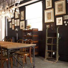 LOVE the dark wall, wood, metal, and glass mixed together. Industrial, yet posh.