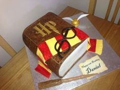 HARRY POTTER BOOK - * this cake was really easy to make, the 'leather' effect was made by mixing food colour with vodka and then just dabbing on with a makeup brush, you could probably get the same effect by using scrunched up newspaper