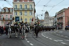 Flag bearers, musicians and swordsmen arrive on horseback for the changing of the guard ceremony in Lisbon. Changing of the Guard in Lisbon occurs on the 3rd Sunday of each month at 11 am, Palacio de Belem, Belem District, Lisbon, Portugal.   The ritual began back in 1910 when the Portuguese monarchy were ousted and Portugal became a republic. It involves a lot of choreographed marching and serious faces on the part of the guards on foot, accompanied by the music of the brass band.