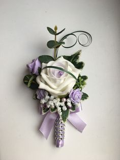 Lilac and ivory ladies buttonhole.