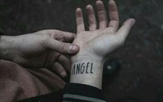 The Angels had this tattooed on their wrist. It was said that when you fell there archangels they slashed the words and they let you fall, hoping you would die on the way down